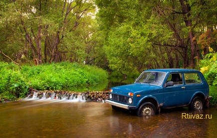 SUV and waterfall